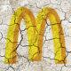 Cracked facade of the golden arches