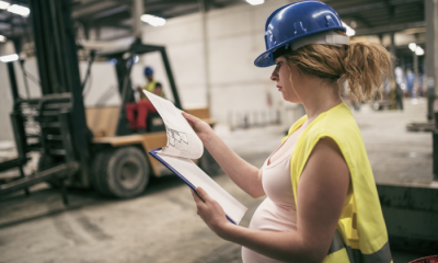 Pregnant worker in a hard hat